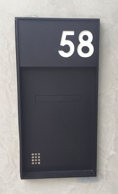 image of custom mailbox box built into wall with integrated keypad